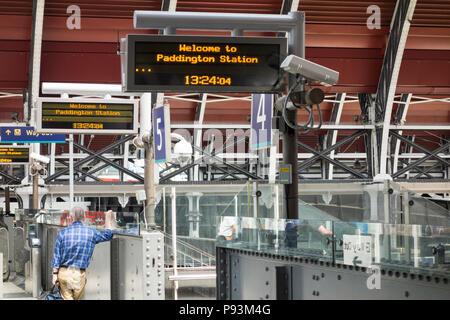 Welcome to Paddington Station - a male passenger waiting for a train at Paddington Station, London, UK - Stock Image