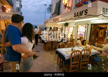 Spain Baleares island Ibiza town by night restaurants near harbour Sa Penya - Stock Image