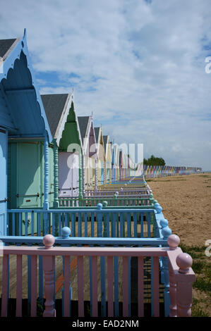 Colourful beach huts on the beach, Mersea Island, Essex - Stock Image