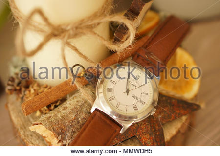 Timex men watch lying next to a candle in soft focus - Stock Image