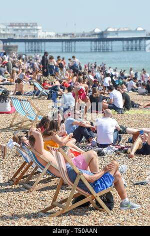 Brighton, UK. 19th Apr, 2019. Brighton beach is packed as Good Friday visitors enjoy the sizzling sunny weather as temperatures reach the mid twenties along the South Coast Credit: Simon Dack/Alamy Live News - Stock Image