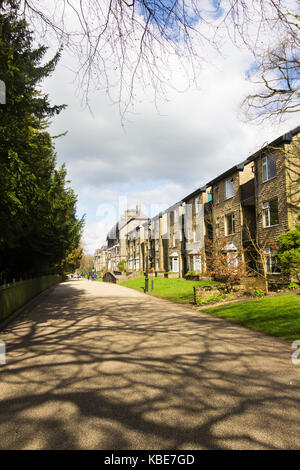 Broad Walk, Buxton, adjacent to the Pavilion Gardens. Modern flats have been built from materials designed to be - Stock Image