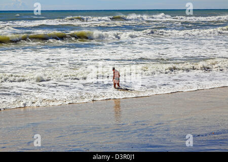 Severe weather lone bather defies stay out of water order as heavy swell and dangerous rips batter coastline - Stock Image