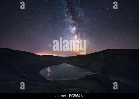 Ireland Landscape nihgt at Wicklow Mountains and Milky Way above Lough Tay in Ireland - Stock Image