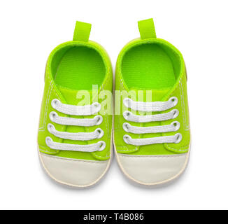 Pair Of Green Baby Shoes Top View Isolated on White Backround. - Stock Image