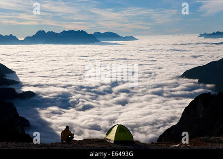 Camping above the clouds at sunrise, The Dolomites, Italy - Stock Image