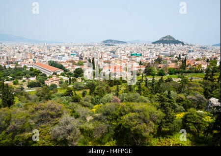 Athens, Greece. View from Areopagus below the Acropolis.  With the Stoa of Attalos and Mount Lycabettus. - Stock Image