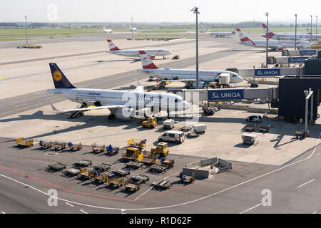 Luggage being loaded onto a Lufthansa passenger jet at Vienna International Airport - Stock Image