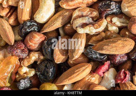 Mixture of nuts and dried fruit in close up - Stock Image