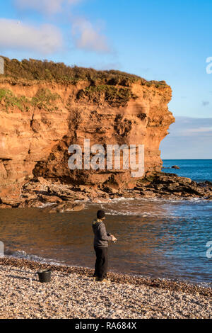 Budleigh Salterton, Devon, 1st Jan 19, A sea angler enjoys the late afternoon in Budleigh Salterton, Devon. Photo Central / Alamy Live News - Stock Image
