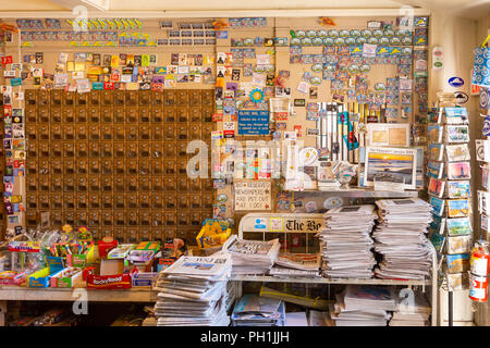 A post office and goods for sale inside historic Alley's General Store, established in 1858, in West Tisbury, Massachusetts on Martha's Vineyard. - Stock Image