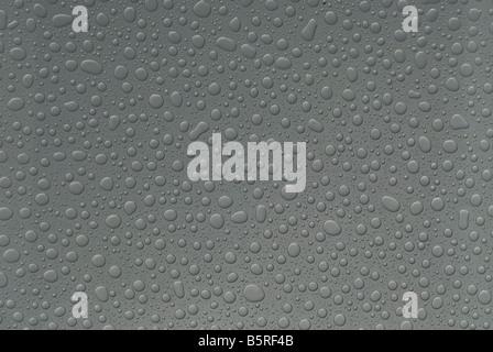 Raindrops on glass - Stock Image