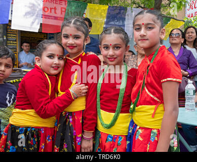 Beautiful young Nepalese girls in colorful costumes prior to performance celebrating the  anniversary of the first successful climb of Mount Everest. - Stock Image