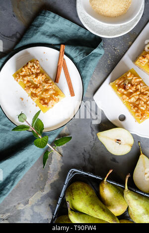 Homemade pear bars with wholegrain dough and walnut - Stock Image