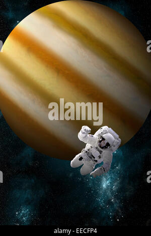 Artist's concept of an astronaut floating in outer space. An Jupiter-like planet forms the background. - Stock Image