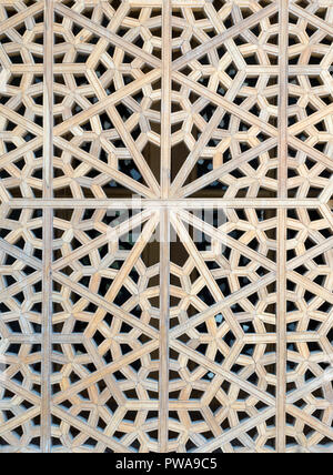 Wooden islamic pattern on a window at Shah mosque, Isfahan, Iran - Stock Image