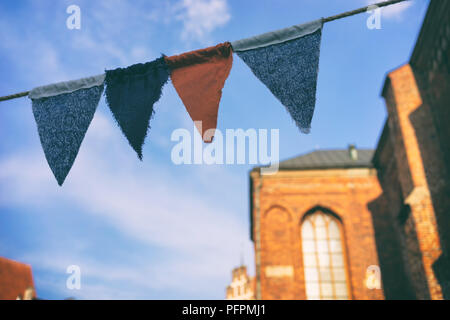 Flags made of cloth in the old town at the fair - Stock Image