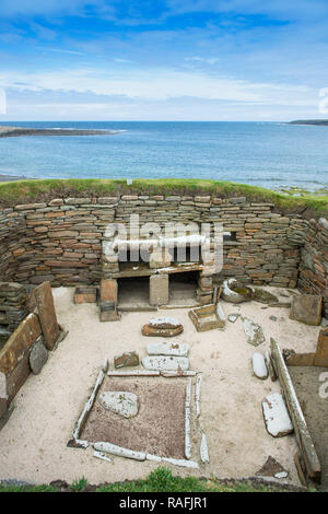 Remains of one of the homes at Skara Brae, a stone-built Neolithic village on the west coast of the Orkney Islands in Scotland - Stock Image