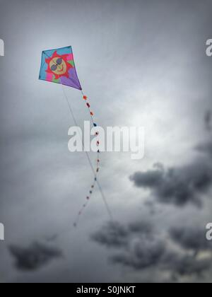 Kite flying with dramatic sky - Stock Image