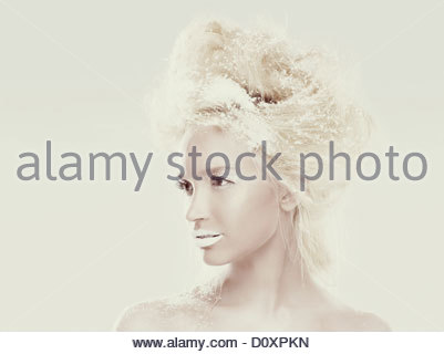 Ice maiden with snowflakes in hair - Stock Image