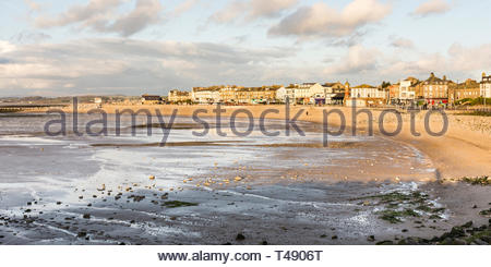 The curving seafront and promenade of Morecambe, Lancashire, England, UK in the evening sunlight - Stock Image