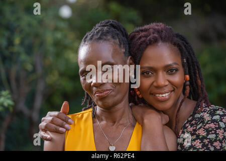 Closeup of a woman and her mother in a garden - Stock Image