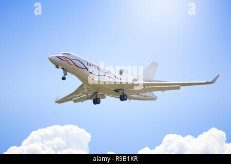 A private jet comes in for a landing near Palm Beach International Airport. - Stock Image