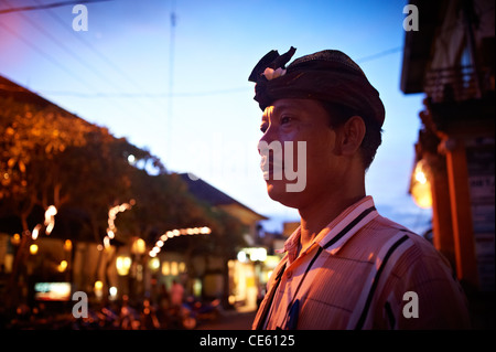Balinese man on the street at night, Ubud Indonesia - Stock Image