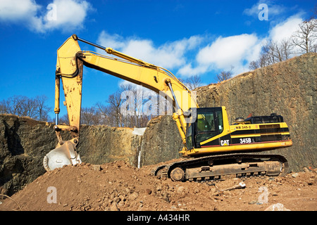 outdoors, building, vehicle, vehicles, hardware, development, destruction, stone, rocks, rock, industry, construction, - Stock Image