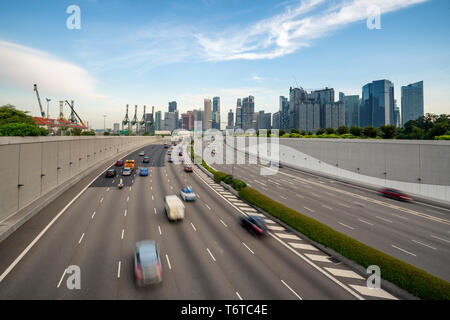 Singapore city, Marina bay finance and trade zone with traffic in city in morning at Singapore. Asia - Stock Image