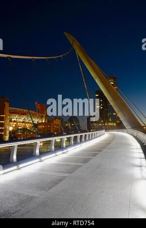 The iconic, modern 500-feet long Harbor Drive Pedestrian Bridge at sunrise, connects Petco Park to San Diego Bay and Convention Center, San Diego, USA - Stock Image