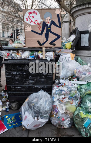 London, UK, 23rd March 2019. A million protestors march against Brexit and in support of a second referendum. Placard of Theresa May in a rubbish bin - Stock Image