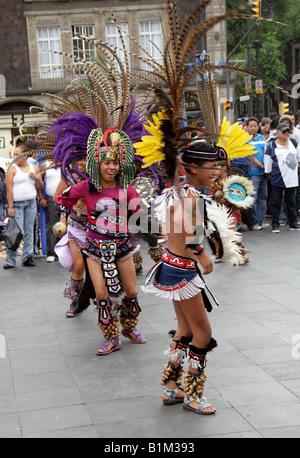 Young Mexican Dancers in Aztec Costume Zocalo Square Plaza de la Constitucion Mexico City Mexico - Stock Image