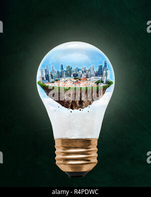 Floating city of Singapore inside light bulb with copy space. Concept of eco-friendly, energy efficient city and idea of environmental conservation in - Stock Image