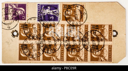 Scarce 1916 Swiss luggage label with multiple 'William Tell' stamps... correct franking for 13,8 kilos weight. - Stock Image