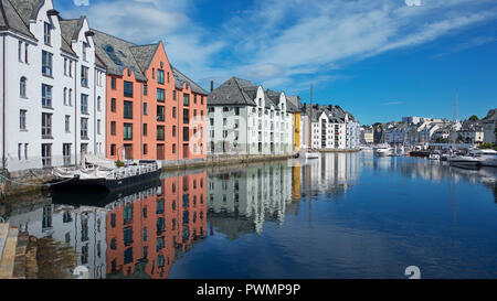 View of the famous clear blue canal lined up with Art Nouveau architectural style buildings, a Scandinavian picturesque town, Alesund, Norway - Stock Image