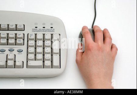 Doug Blane Computer mouse and keyboard with a hand on the mouse concept image representing RSI WRULD - Stock Image