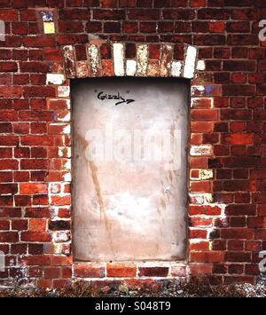 Blocked in Window in Brick Wall - Stock Image