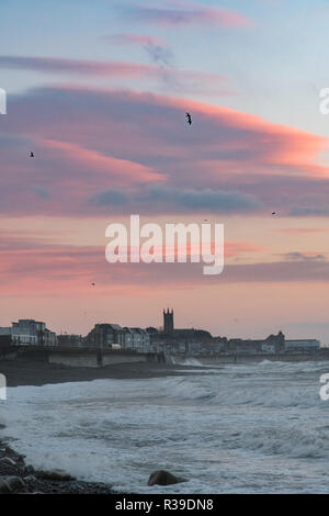 Newlyn, Cornwall, UK. 22nd November 2018. UK Weather. Strong cold winds were hitting the seafront at Newlyn this morning at sunrise. Credit: Simon Maycock/Alamy Live News - Stock Image