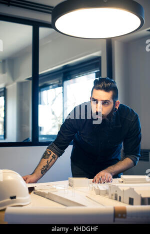 Architect working in office - Stock Image