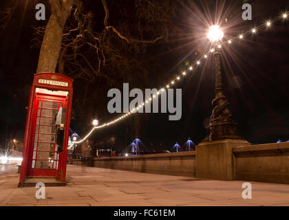 Traditional English Red Phone Box in London - Stock Image