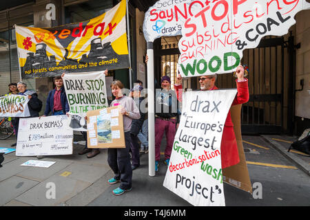 London, UK. 17th Apr, 2019. Protesters at the Drax AGM demand an end to burning wood at Drax power station, the UK's biggest carbon emitter. Drax emitted over 13m tonnes of CO2 from burning wood in 2018, and plans to become the largest gas power station in the UK. AxeDrax demand an end to the subsidies for burning wood for which Drax got £789m in 2018. Credit: Peter Marshall/Alamy Live News - Stock Image