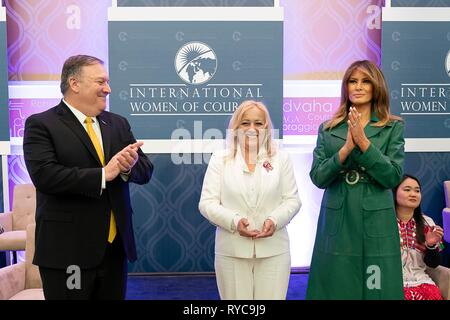 U.S First Lady Melania Trump, right, and Secretary of State Mike Pompeo, left, present Olivera Lakic of Montenegro with the 2019 International Women of Courage awards at the State Department March 7, 2019 in Washington, DC. - Stock Image