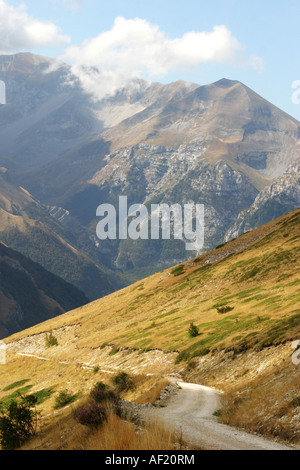 pretty country  road curves round the Glorious slopes of Monte Sibilla in the Sibillini National Park Le Marche - Stock Image