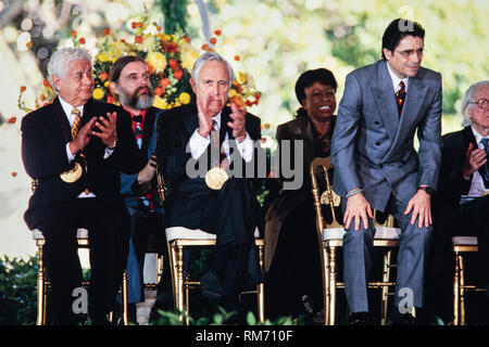Artistic Director of the Miami City Ballet Edward Villella, right, stands as he is called to receive his National Medal of Arts award during a ceremony on the South Lawn of the White House September 29, 1997 in Washington, DC. Sitting left to right are: Percussionist Tito Puente, Jean Louis Bourgeois, Actor Jason Robards, Singer Betty Carter and Villella. - Stock Image