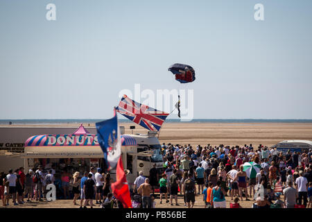 British Military personnel parachuting on to the beach during the 2018 Southport Airshow - Stock Image