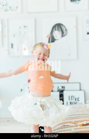 Happy girl dancing - Stock Image
