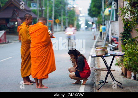 Thailand, Mae Hong Son, Mae Hong Son. Monks on morning alms round. - Stock Image
