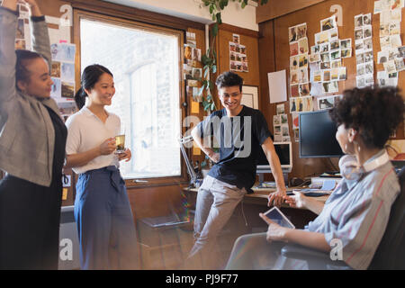 Creative designers meeting in office - Stock Image
