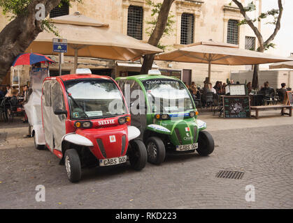Inner city electric cabs in Valetta Malta waiting for customers - Stock Image
